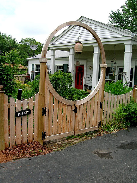Wooden Halo Over A Double Gate By Elyria Fence Inc