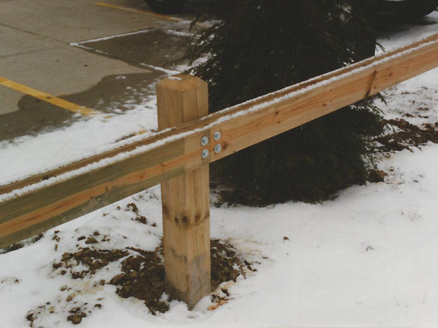 Wooden guard rail fencing by elyria fence