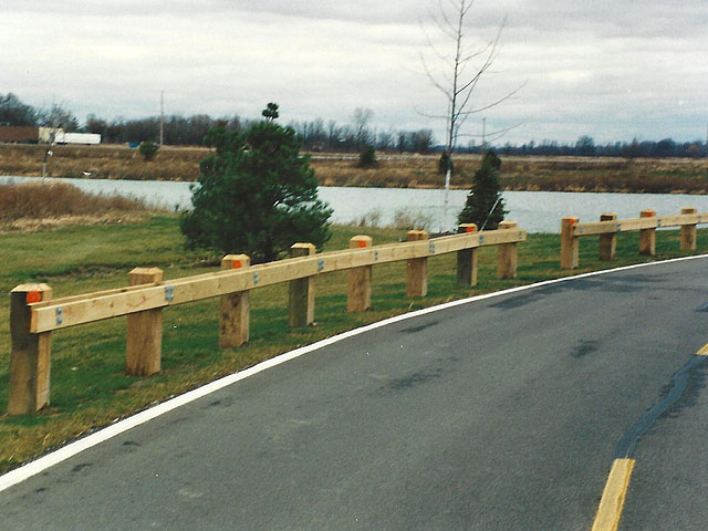Wooden guard rail fence by elyria