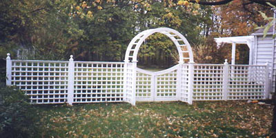 Cedar lattice fence by Elyria Fence