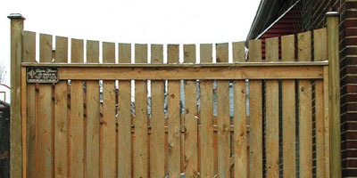 Sabre Scallop Cedar Picket Fencing by Elyria Fence