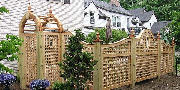 Good Neighbor Arched Square Lattice Fence Designs by Elyria Fence.