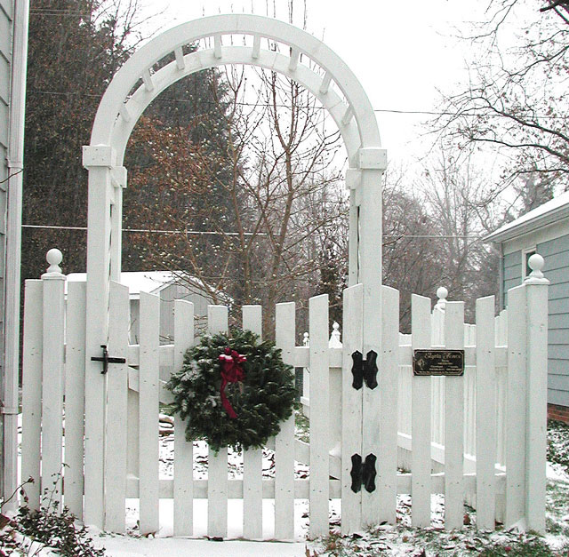 Spaced Sabre Scalloped Wood Picket Fence with Arbor & Gate by Elyria Fence