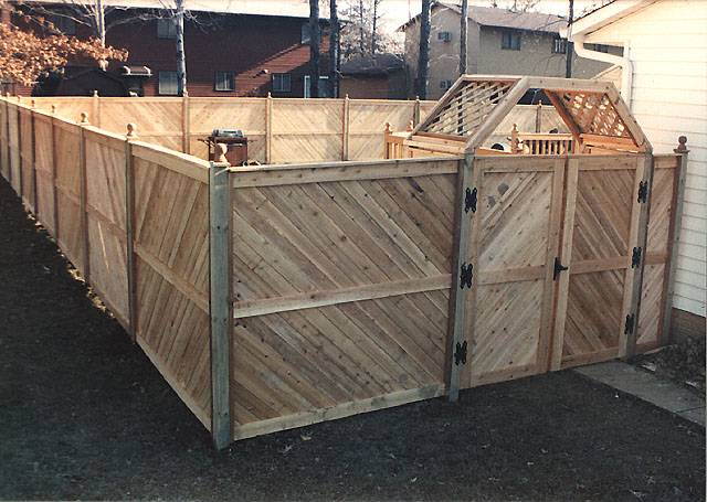 White Cedar Wood Privacy Fence With Arbor and gate by Elyria Fence