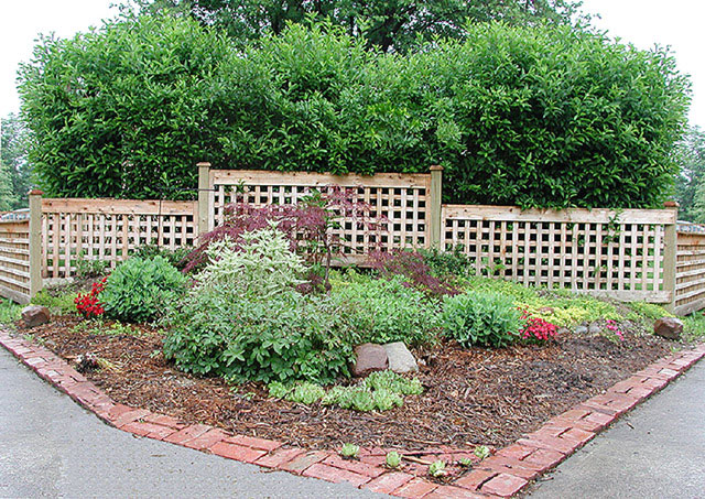 good neighbor square lattice garden fence by elyria fence