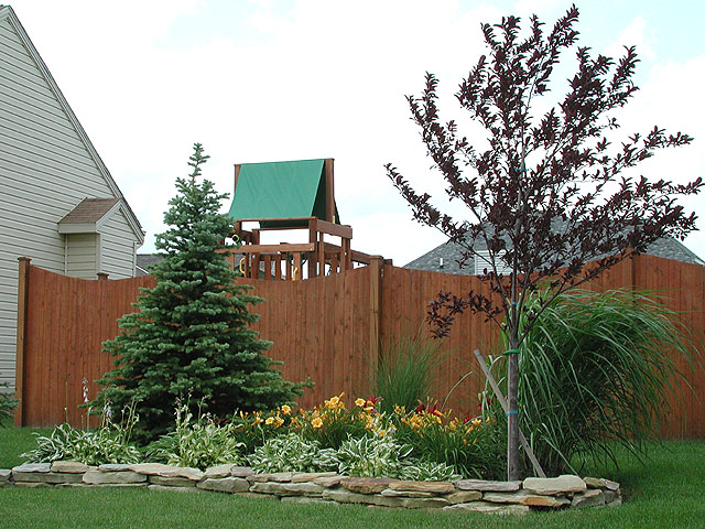 Sabre Scallop Wood Privacy Fence by Elyria Fence