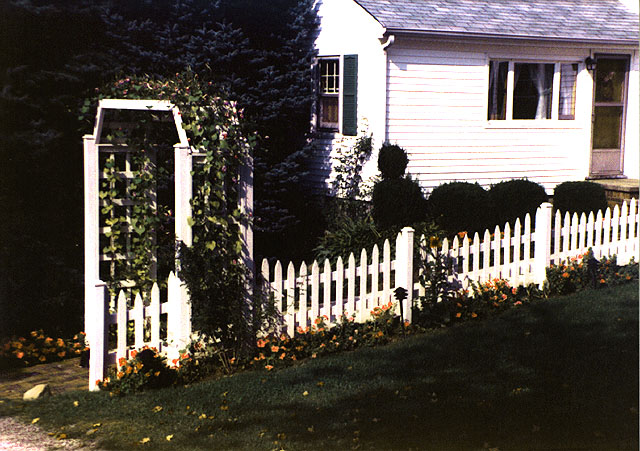 white cedar wood picket fence with arbor by Elyria Fence