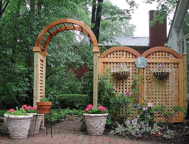 Arched arbor with moon gate and english trellis fence for Timber garden arch designs