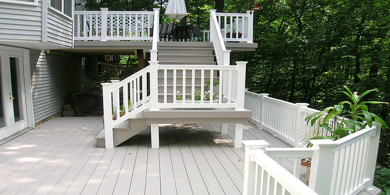 Azek Composite Deck with Vinyl Railing by Elyria Fence