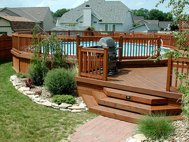 Custom Wood Deck Around A Pool By Elyria Fence