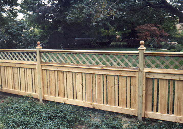 Semi-private wood fence with lattice by Elyria Fence