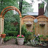 wood garden arbor with arched square lattice vine trellis by elyria fence