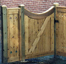 square lattice wood fence with arched square lattice gate by Elyria Fence