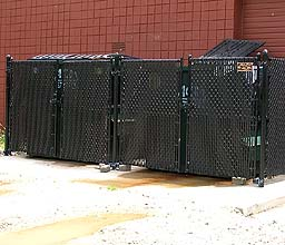 Black Vinyl Coated Chain Link Fence With Privacy Weave by elyria fence