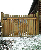 wood spaced sabre scallop fence by elyria fence