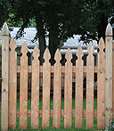 spaced scalloped wooden white cedar imperial picket fence with finials posts by Elyria Fence