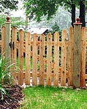 spaced scalloped white cedar wooden classic fence by elyria fence