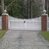 Wood spaced scalloped picket fence, reverse runner by Elyria Fence