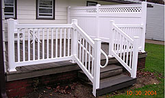 vinyl railing with ADA handrail by Elyria Fence
