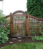 Arched Square Lattice Gate With Scalloped Square Lattice Fence by Elyria Fence