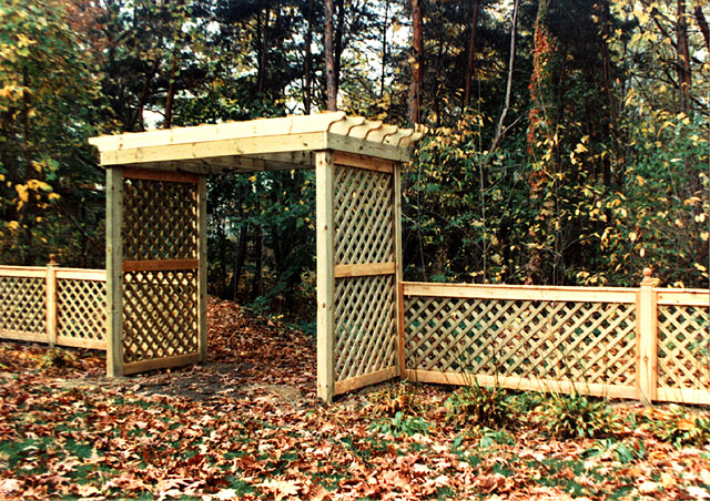 Custom Pergola With Diagonal Lattice By Elyria Fence